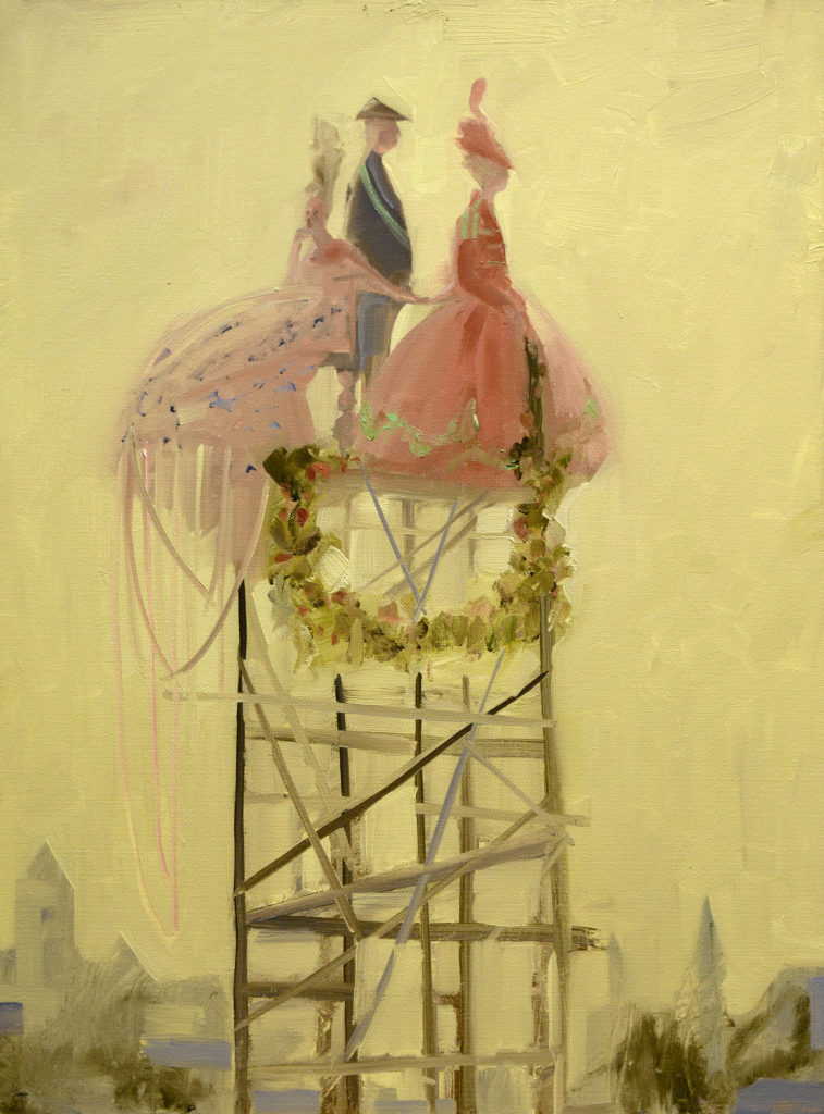 three fancifully dressed people stand atop wreathed scaffold