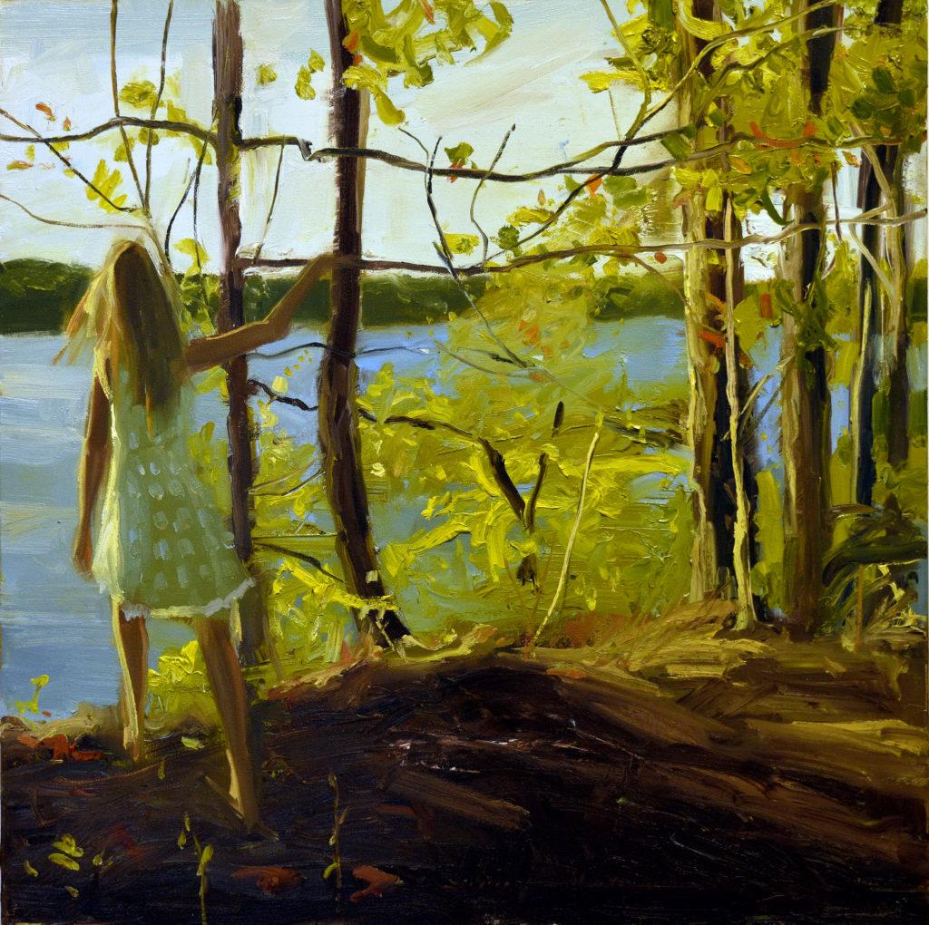 girl gazes out onto sunlit lake