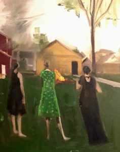 Three women gaze at burning tree