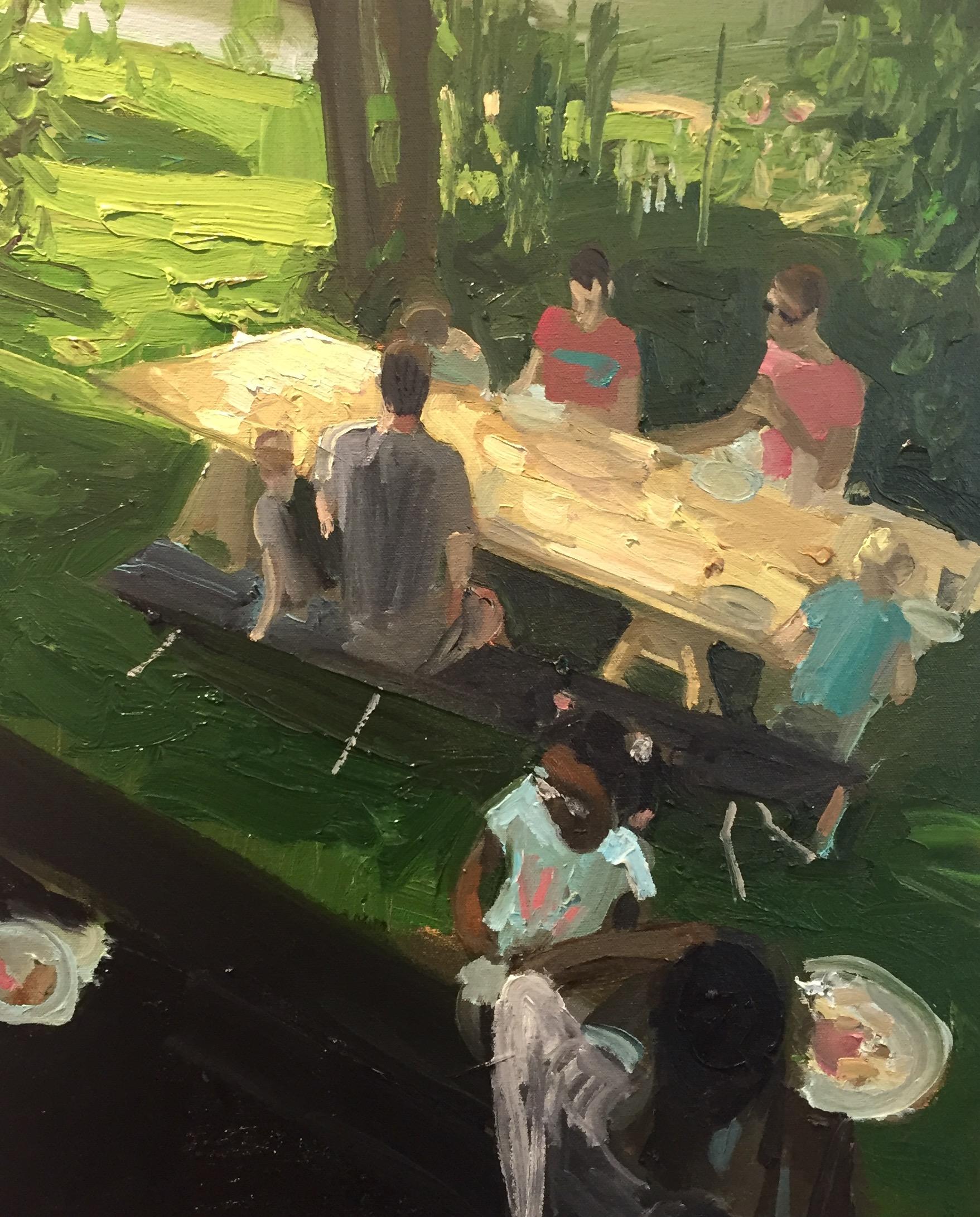 Neighbors share dinner outside on a new, handmade table